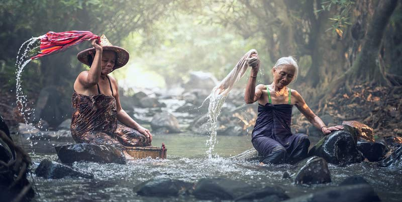 old women washing clothes in the river in Cambodia